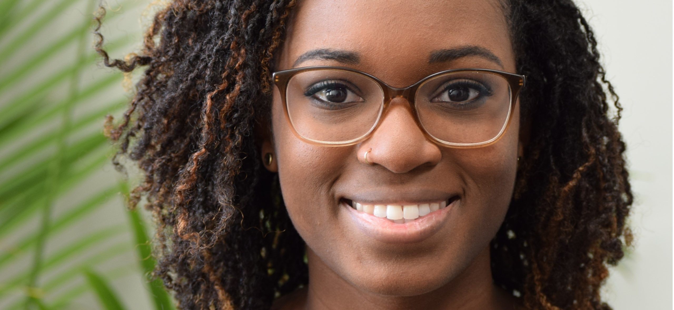 young-woman-with-glasses-Cary NC Therapist Serena Wilson